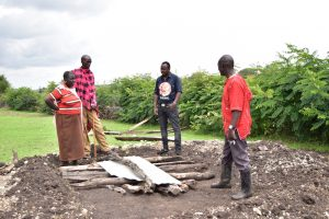 Building toilets at the homes of the community